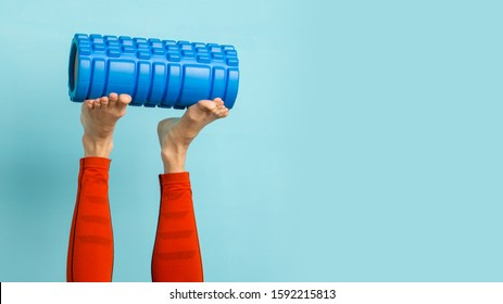 Young woman ready to do Fascia Training holding a Fascia Roll
