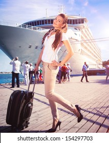 Young woman ready to travel on cruise ship