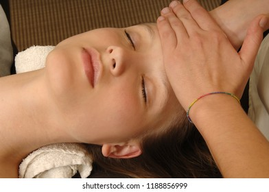 young woman receives body treatment in spa salon