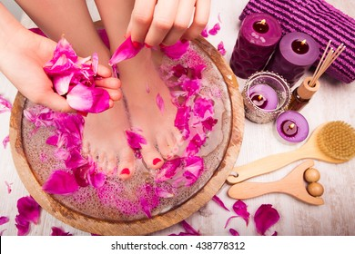 Young woman receives a foot massage in the spa salon