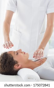 Young woman receiving alternative therapy at health spa