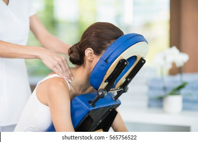 Young woman receiving back massage from physiotherapist