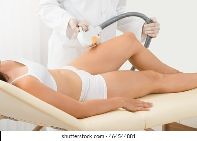 Young Woman Receiving Laser Epilation On Beauty Center
