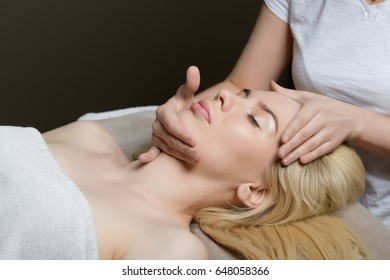 Young woman receiving massage at spa salon