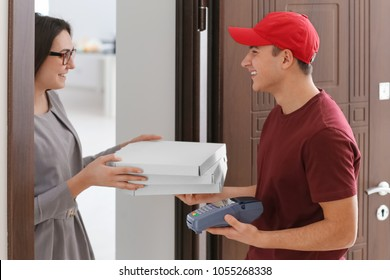 Young woman receiving order from courier. Food delivery service