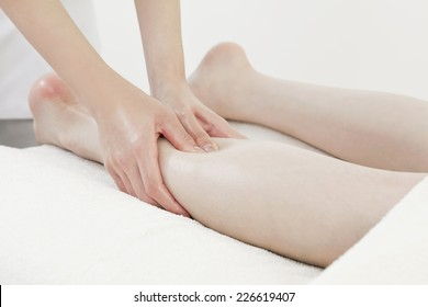 Young woman receiving a reflexology foot massage