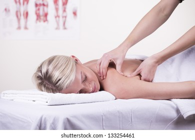 Young woman receiving shoulder massage