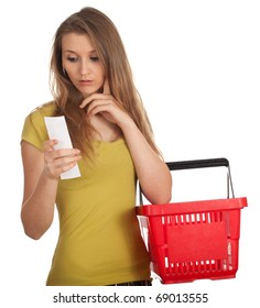young woman with red basket checking purchases list