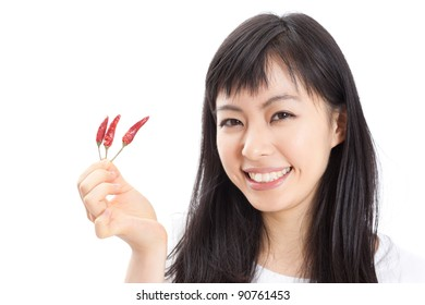 young woman with red chili pepper isolated on white background