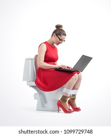 Young woman in red dress and glasses working on laptop sitting on toilet