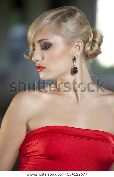 Young woman in red dress in vintage look