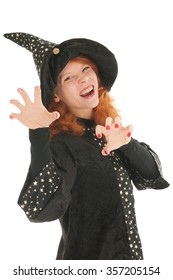 Young woman with red hair as evil witch isolated over white background
