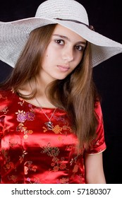 Young woman in red. With hat. Chinese styled.