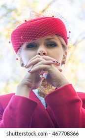 Young woman in red hat and red coat