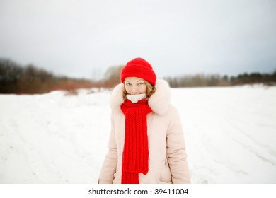 Young woman in red hat and scarf