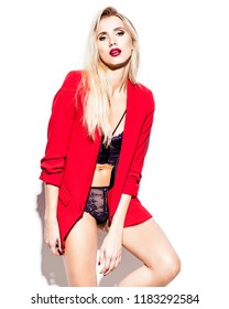 Young woman in red jacket and lingerie posing on white background in bright light