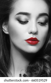 Young woman with red lipstick on lips