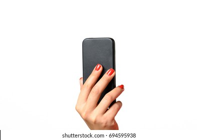 Young woman with red painted fingernails holding a mobile phone in the air with the back towards the camera, close up isolated on white
