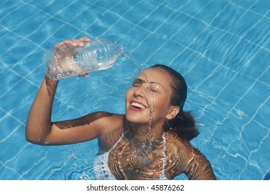 young woman refreshing at the pool