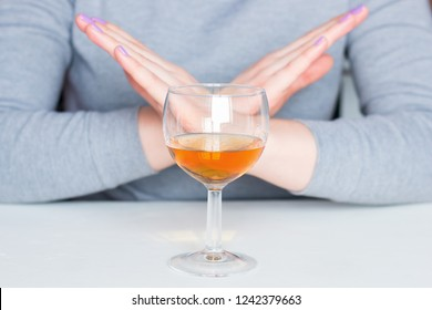 young woman refuses alcohol. stop alcoholism