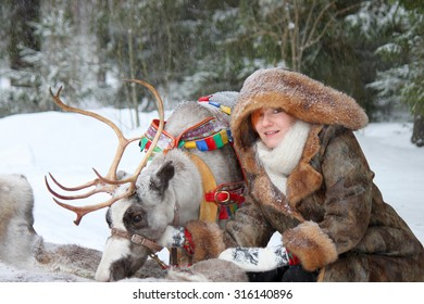 Young woman and reindeer winter