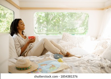 Young woman relax in bed, camping in a trailer