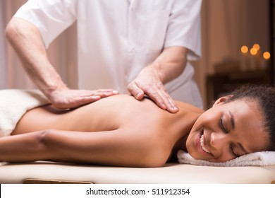 Young woman relaxing during pleasant back massage