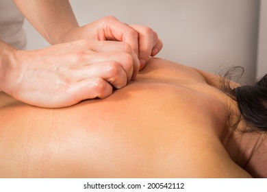 Young woman relaxing with hand massage at beauty spa