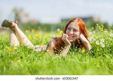 Young woman relaxing, happy in summer meadow