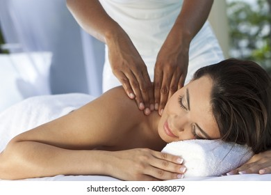 A young woman relaxing at a health spa while having a massage