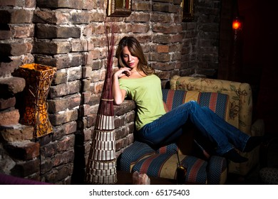young woman relaxing at home, indoor shot