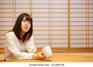 Young woman relaxing at Japanese Style Room