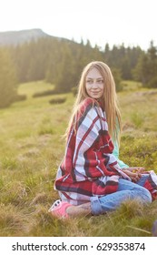 Young woman relaxing in mountains