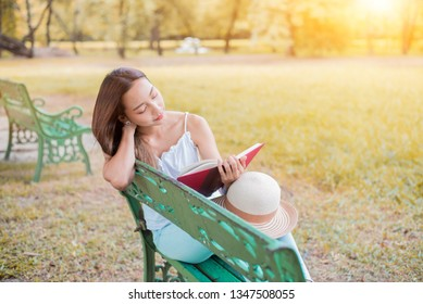 Young woman relaxing in the natural park. Studen on vacation and summer holiday in the garden.
