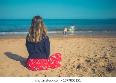 A young woman is relaxing on the beach