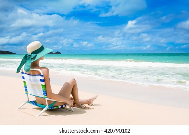Young woman relaxing on a beautiful exotic beach. (location Hawaii)