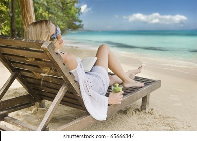 Young woman relaxing on a beautiful Caribbean beach.