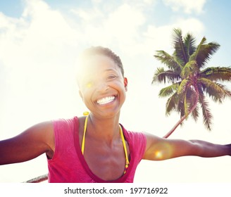 Young woman relaxing on a tropical beach.