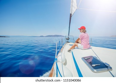Young woman relaxing On Yacht in Greece