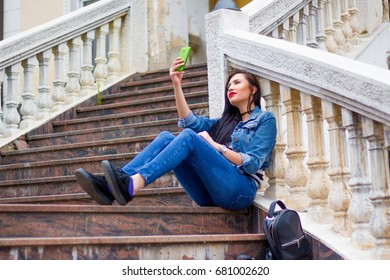Young woman relaxing outdoor and make selfie.