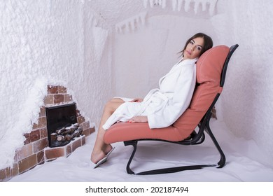 Young woman relaxing in the salt room