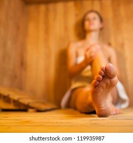 Young woman relaxing in a sauna