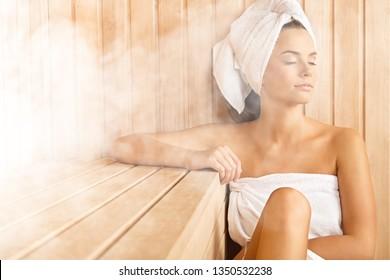 Young woman relaxing in sauna