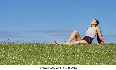 Young woman relaxing in the sunshine outdoors