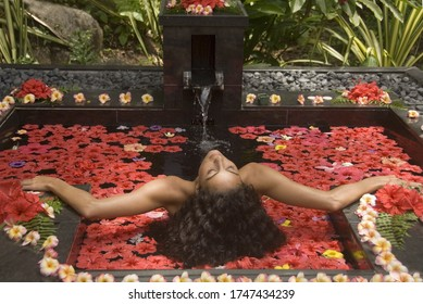 Young woman relaxing at tranquil spa