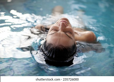 Young woman relaxing in the water