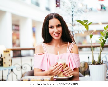 young woman rest in cafe after shopping