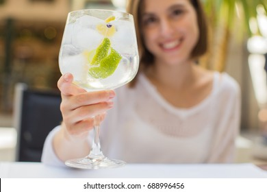 young woman in a restaurant with gintonic