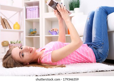 Young woman resting with  tablet at home