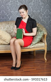 young woman rests on a sofa with a book